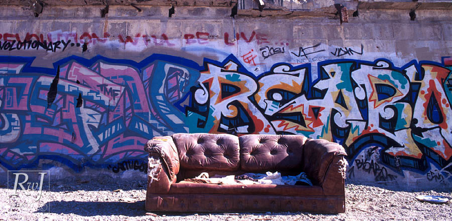 Old couch at factory wall